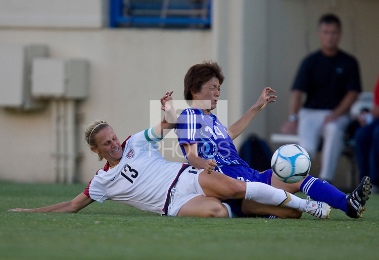 Kristine Lilly slides into Yukari Kinga. USA defeated Japan 4-1 at Spartan Stadium in San Jose, CA on July 28, 2007.