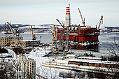 The ice-resistant Prirazlomnaya oil platform is being outfitted by Gazprom on the coast of Murmansk City before being towed to the Prirazlomnoye oil field in the eastern part of the Pechora Sea about 60 km north of the Nenets Autonomous Okrug. <br />