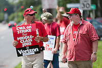 HARTSDALE, NY - AUGUST 9: On-strike Verizon employees, members of the Communications Workers of America (CWA), picket on the street in front of a Verizon Wireless store in Hartsdale, New York.  The strike began on August 7th, 2011 due to the CWA's unhappiness with Verizon management's stance in bargaining a new contract.