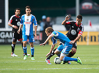 Marcelo Saragosa (11) of D.C. United collides with Brian Carroll (7) of the Philadelphia Union during the game at the RFK Stadium in Washington DC.  Philadelphia defeated D.C. United, 3-2.