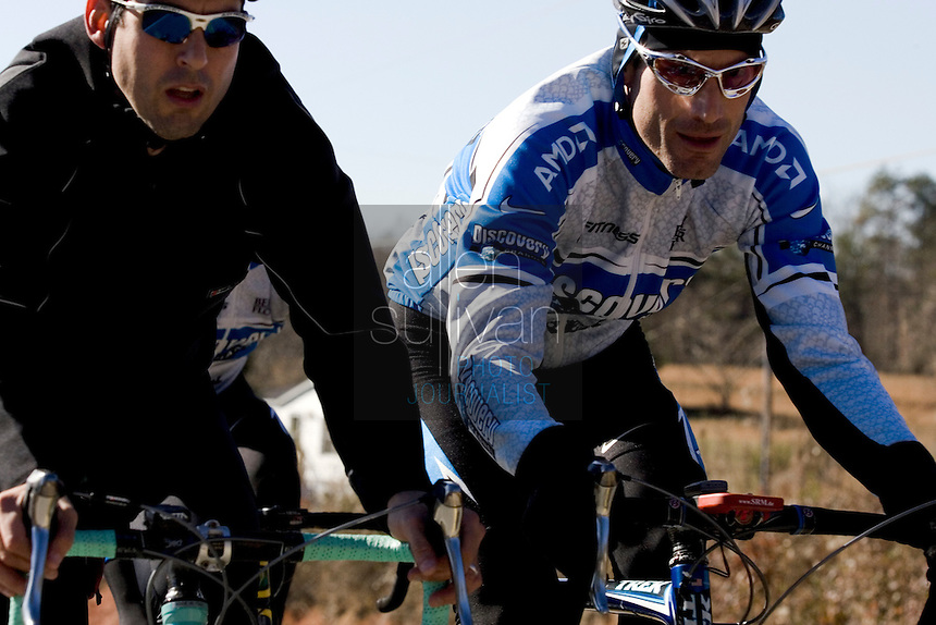 Discovery Channel Pro Cycling Team racer George Hincapie (right) and his brother Rich on a training ride. Long successful in the European classics, in addition to being Lance Armstrong's right hand man on the team, Hincapie took his first Tour de France stage win in 2005.<br />