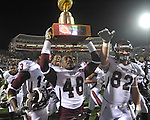 Missisippi State players celebrate at Vaught-Hemingway Stadium on Saturday, November 27, 2010. Mississippi State won 31-23.