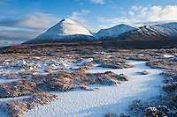 Winter view of snow covered landscape and Red Cuillin hills, Isle of Skye, Scotland