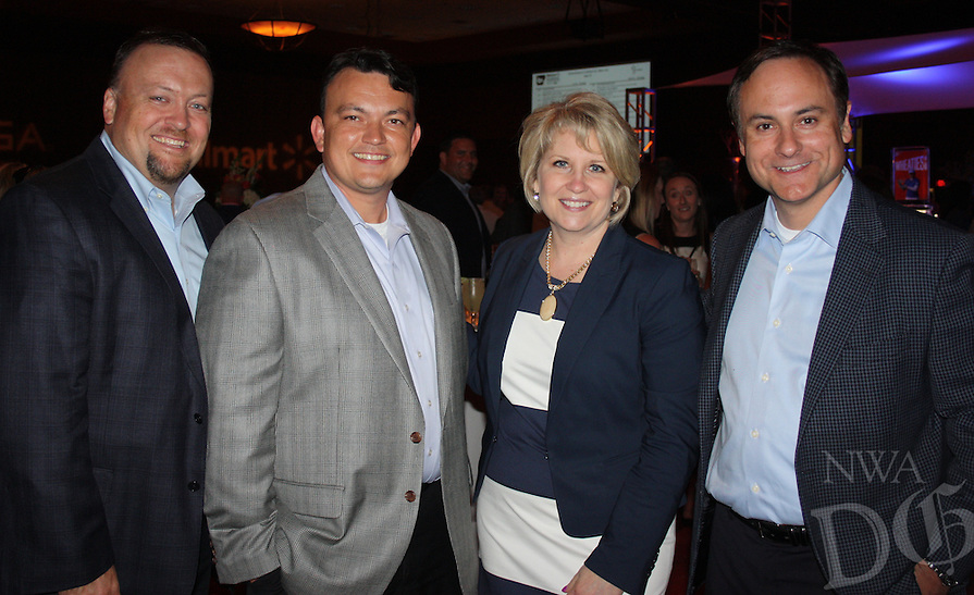 STAFF PHOTO CARIN SCHOPPMEYER Adam Dill, from left, Josh Yates, Mary Zettle and Scott Tassani, of General Mills, attend the Champions Party.