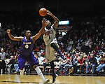 "Mississippi's Martavious Newby (1) is fouled by Lipscomb's Khion Sankey (0) in the first half at the CM. ""Tad"" Smith Coliseum in Oxford, Miss. on Friday, November 23, 2012. (AP Photo/Oxford Eagle, Bruce Newman)"
