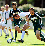1 September 2009: University of Vermont Catamount midfielder/forward Lukas Petersen, a Sophomore from Burlington, VT, keeps the ball from Siena College Saints' midfielder Daniel Alderstad (14), a Freshman from Solna, Sweden at Centennial Field in Burlington, Vermont. The Saints edged out the Catamounts 1-0. Mandatory Photo Credit: Ed Wolfstein Photo