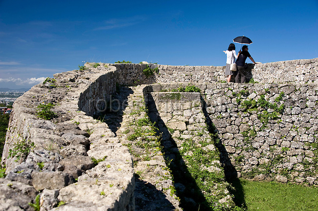 Visitors enjoy the view from the 3rd enclosure of Nakagusuku Castle ruins in KITA-NAKAGUSUKU VILLAGE, Okinawa Prefecture, Japan, on May 20, 2012. Photographer: Robert Gilhooly