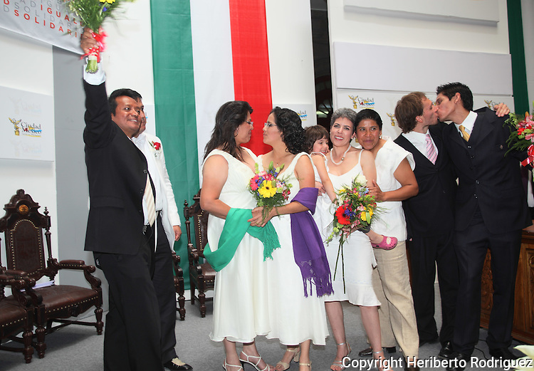 Daniel Ramos Gómez and Marco Antonio Temistocles Villanueva Ramos (L), Judith Minerva Vázquez Arreola with Lol Kin Castañeda Badillo (2nd L), Emma Estrellita Lauria Viilanueva and Janice Jeanette Alva Vázquez and Jaime Genaro López Vela y David Sergio González Garduño kiss each other after being married in a civil ceremony at the City Hall on March 11, 2010. For the first time in Mexico the gay marriages are being legalize although the Catholic church and the Felipe Calderon's government are opposing to the gay rights.  Photo by Heriberto Rodriguez