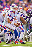 19 October 2014: Buffalo Bills quarterback Kyle Orton takes a snap in the second quarter against the Minnesota Vikings at Ralph Wilson Stadium in Orchard Park, NY. The Bills defeated the Vikings 17-16 in a dramatic, last minute, comeback touchdown drive. Mandatory Credit: Ed Wolfstein Photo *** RAW (NEF) Image File Available ***