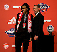 MLS executive vice president Todd Durbin welcomes  Zac Herold to the stage as the 24th overall pick of  the MLS Superdraft by Toronto FC at the Pennsylvania Convention Center in Philadelphia, PA.