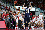 25 January 2015: NC State's Cody Martin (15) dives past Notre Dame's Steve Vasturia (32) in an attempt to keep the ball in play. The North Carolina State University Wolfpack played the University of Notre Dame Fighting Irish in an NCAA Division I Men's basketball game at the PNC Arena in Raleigh, North Carolina. Notre Dame won the game 81-78 in overtime.