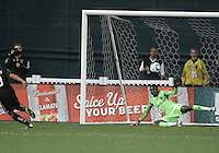 Charlie Davies (9) of D.C. United turns away after beating Donovan Ricketts (1) of the Los Angeles Galaxy with a penalty kick for the tying goal during an MLS match at RFK Stadium, on April 9 2011, in Washington D.C.The game ended in a 1-1 tie.