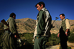 Three Kurdish Worker's Party (PKK) fighters stand on a hill above one of the party's bases near the Iraqi-Kurdish border on Sept. 20, 2006.