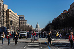 Pedestrians wander along Pennsylvania Avenue, closed to traffic ahead of tomorrow's Inaugural Parade, on Sunday, January 20, 2013 in Washington, DC.