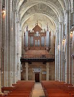 Organ, commissioned in 1903, in the nave of the Collegiale Notre-Dame de Poissy, a catholic parish church founded c. 1016 by Robert the Pious and rebuilt 1130-60 in late Romanesque and early Gothic styles, in Poissy, Yvelines, France. The instrument was made by Charles Mutin, its neogothic wooden casing was designed by the architect Camille Formige, working on the restoration under Viollet-le-Duc in 1884-96 and the stone columns below were sculpted by Geoffroy. The Collegiate Church of Our Lady of Poissy was listed as a Historic Monument in 1840. Picture by Manuel Cohen