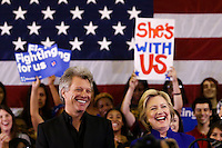 NEWARK, NJ - JUNE 01 : U.S. Democratic presidential candidate Hillary Clinton and singer Jon Bon Jovi smile as they attend a campaign rally on June 01, 2016 in Newark, New Jersey. Hillary Clinton only needs 73 delegates to clinch the party's nomination. on June 7 New Jersey will hold its primary elections, a state that will be awarding 142 total Democratic delegates. Photo by VIEWpress