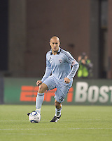 Sporting Kansas City defender Aurelien Collin (78) brings the ball forward. In a Major League Soccer (MLS) match, the New England Revolution defeated Sporting Kansas City, 3-2, at Gillette Stadium on April 23, 2011.