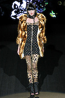 Steph walks runway in a Jungle Fever outfit, from the Betsey Johnson Fall 2011 He Loves Me Not - Black Tag collection, during Mercedes-Benz Fashion Week Fall 2011.