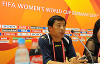 Kwang Min Kim, Coach of North Korea, during a press conference at the FIFA Women's World Cup at the FIFA Stadium in Dresden, Germany on June 27th, 2011.