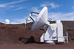 Mauna Kea, Big Island of Hawaii, Hawaii; a Submillimeter Radio Telescope located at the summit of the Mauna Kea Observatories (MKO), with the Canada-France-Hawaii Telescope, Gemini Northern 8-meter Telescope, UH 0.6-meter Telescope and the United Kingdom Infrared Telescopes in the background, currently there are 13 independent multi-national astronomical research facilities located on the summit. Mauna Kea's altitude and isolation in the middle of the Pacific ocean make it an ideal location for astronomical observation.