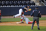 Western Kentucky's Casey Dykes (16) is safe at third as Ole Miss' Preston Overbey(1) takes the throw at Oxford-University Stadium in Oxford, Miss. on Wednesday, March 9, 2010.
