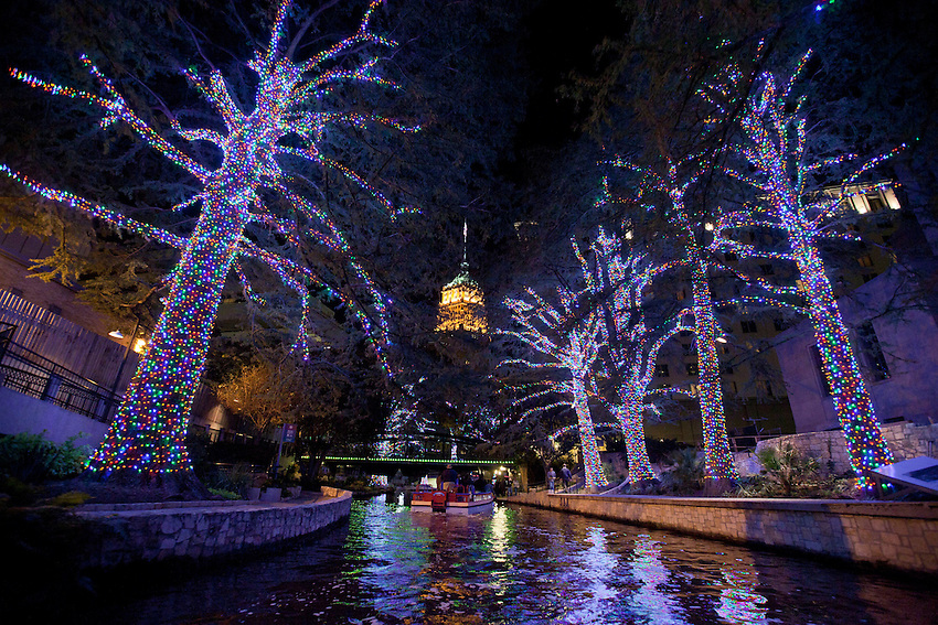 Holiday lights illuminate the world famous River Walk as a barge sails through downtown San Antonio, Thursday, Nov. 17, 2011. The 1.8 million LED lights use half the electricity as the 122,000  incandescent lights utilized in previous years, making one of the nation's top holiday cities an eco-friendly destination. (Darren Abate/VisitSanAntonio.com)