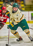 14 December 2013: University of Vermont Catamount Defenseman Rob Hamilton, a Freshman from Calgary, Alberta, in third period action against the Saint Lawrence University Saints at Gutterson Fieldhouse in Burlington, Vermont. The Catamounts defeated their former ECAC rivals, 5-1 to notch their 5th straight win in NCAA non-divisional play. Mandatory Credit: Ed Wolfstein Photo *** RAW (NEF) Image File Available ***