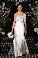 Model walks runway in a Dream wedding dress by Sarah Jassir, for the Sarah Jassir Fall 2011 - Desire bridal collection.