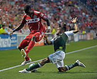 Portland defender Jeremy Hall (17) slide tackles the ball away from Chicago defender Jalil Anibaba (6).  The Portland Timbers defeated the Chicago Fire 1-0 at Toyota Park in Bridgeview, IL on July 16, 2011.