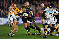Semesa Rokoduguni of Bath Rugby takes on the Wasps defence. European Rugby Champions Cup match, between Bath Rugby and Wasps on December 19, 2015 at the Recreation Ground in Bath, England. Photo by: Patrick Khachfe / Onside Images