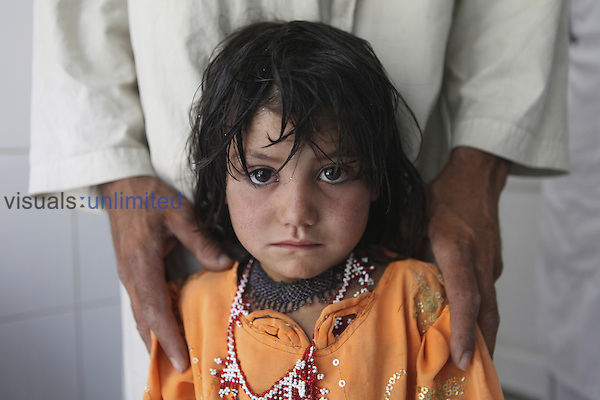 Young girl patient in the pediatric ward of an Afghanistan hospital