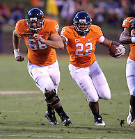 Oct 23, 2010; Charlottesville, VA, USA;  Virginia Cavaliers center John Maghamez (66) blocks for Virginia Cavaliers running back Keith Payne (22) during the game at Scott Stadium.  Virginia won 48-21. Mandatory Credit: Andrew Shurtleff