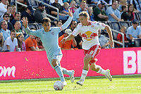 Red Bulls defender Jan Gunnar Solli (8) goes past Omar Bravo (99) Sporting KC...Sporting Kansas City defeated New York Red Bulls 2-0 at LIVESTRONG Sporting Park, Kansas City, Kansas.