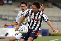 Mexico (26.02.2006) UNAM Pumas defender Israel Castro(L) fights for the ball with Monterrey Rayados midfielder Diego Ordaz during their soccer match at the Mexico City's University Stadium, February 26, 2006. UNAM tied 0-0 to Monterrey. © Photo by Javier Rodriguez..