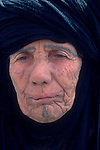 Marsh Arabs. Southern Iraq. Circa 1985. Old woman with tribal tattooed face.