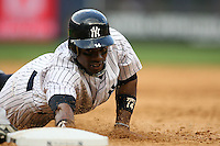 09/19/11 Bronx, NY: New York Yankees center fielder Curtis Granderson #14 during an MLB game played at Yankee Stadium between the Minnesota Twins and the New York Yankees. The Yankees defeated the Twins 6-4.