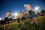 Mountain View player Marcus Jones runs through a receiving line during a pre-game celebration honoring graduating team players Oct. 26.<br />