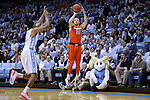 26 January 2015: Syracuse's Trevor Cooney (10) shoots over North Carolina's Brice Johnson (11). The University of North Carolina Tar Heels played the Syracuse University Orange in an NCAA Division I Men's basketball game at the Dean E. Smith Center in Chapel Hill, North Carolina. UNC won the game 93-83.