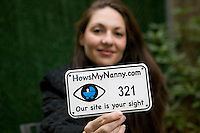 22 November 2006 - New York City, NY - Jill Starishevsky, founder of Howsmynanny.com, poses for the photograph holding a number plate that will be installed on a stroller, in New York City, USA, 22 November 2006. The plate allows people to report any good or bad behaviour by the nanny to the website which then relays it to the parents.