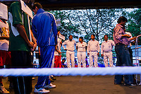 Razia Shabnam stands in the referee / judge line-up at the opening ceremony where she is to referee an all-India invitational boxing competition in the neighbouring town of Burnpur, Calcutta, West Bengal, India. Razia Shabnam, 28, was one of the first women boxers in Kolkata. She was also the first woman in her community to go to college. She is now a coach and one of only three international female boxing referees in India. Photo by Suzanne Lee for Panos London