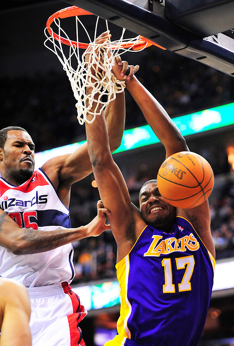 Andrew Bynum of the Lakers is fouled by Wizards' Trevor Booker. Washington defeated Los Angeles 106-101 at the Verizon Center in Washington, D.C. on Wednesday, March 7, 2012. Alan P. Santos/DC Sports Box