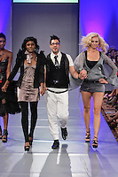 Fashion designer Giovanni Lo Presti, walks runway with models at the close of his runway show, during Couture Fashion Week Spring 2012.