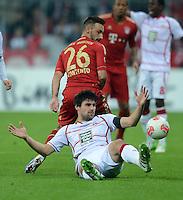 FUSSBALL  DFB POKAL       SAISON 2012/2013 FC Bayern Muenchen - 1 FC Kaiserslautern  31.10.2012 Florian Dick (unten, 1. FC Kaiserslautern) gegen Diego Contento (FC Bayern Muenchen)