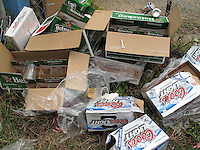 2/15/09---Garbage, empty beer boxes pile up in a trash can during a celebration  in Puerto Rico. .Photo by Angel Valentin, copyright 2009.