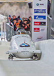 9 January 2016: Russian pilot Alexey Stulnev leads his 4-man team as they cross the finish line after their second run of the day at the BMW IBSF World Cup Bobsled Championships at the Olympic Sports Track in Lake Placid, New York, USA. Stulnev's team came in 7th for the day, with a 2-run combined time of 1:50.42. Mandatory Credit: Ed Wolfstein Photo *** RAW (NEF) Image File Available ***