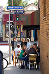 People dining at outdoor cafe on Abbot Kinney Blvd. in Venice, California