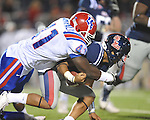 Mississippi quarterback Randall Mackey (1) is tackled by Louisiana Tech's I.K. Enemkpali (41) in Oxford, Miss. on Saturday, November 12, 2011. Mackey lost a fumble on the play.