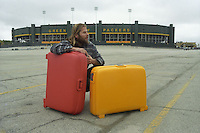 Me and my Roncato suitcases in front of Lambeau Field in October of 1995 as I left Green Bay to retrace Mark Twain's route around the world on the 100th anniversary of his journey.