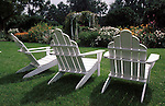 Three white chairs in garden Commonwealth of Virginia,