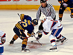 9 December 2006: Buffalo Sabres center Chris Drury (23) faces off against Montreal Canadiens center Saku Koivu (11) of Finland at the Bell Centre in Montreal, Canada. The Sabres defeated the Canadiens 3-2 in a shootout, taking their third contest in the month of December. Mandatory Photo credit: Ed Wolfstein Photo<br />  *** Editorial Sales through Icon Sports Media *** www.iconsportsmedia.com